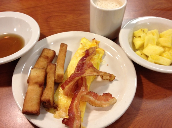 french toast sticks, fruit, and eggs